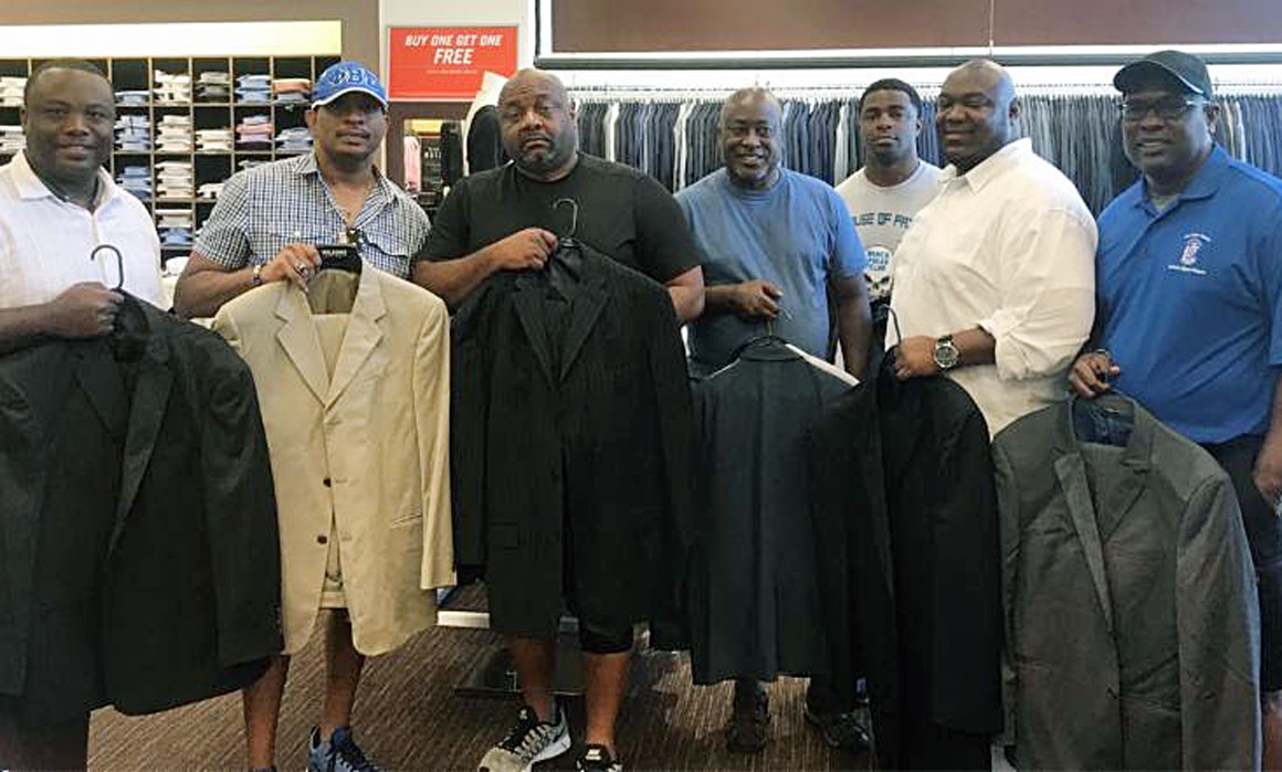 Phi Beta Sigma brothers donating suits for the Men's Wearhouse Annual Suit Drive.